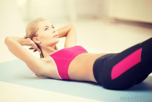 woman-in-pink-sports-bra-and-yoga-pants-doing-a-sit-up